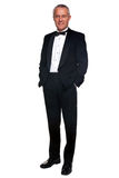 Mature man in tuxedo and black tie.