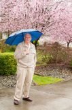 Mature Man with Umbrella in Rain Royalty Free Stock Image
