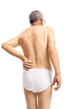 Mature man in underwear suffering from back pain Royalty Free Stock Images