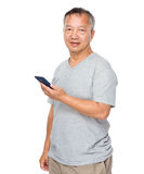 Mature man use of cellphone Stock Photos