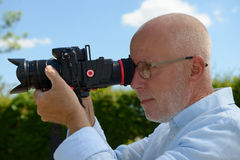 Mature man using camera dslr Royalty Free Stock Photo