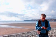 Mature man using mobile phone Stock Photos