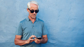 Mature man using mobile phone Stock Photo