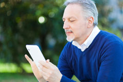 Mature man using a tablet Royalty Free Stock Photo