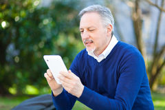 Mature man using a tablet Stock Image