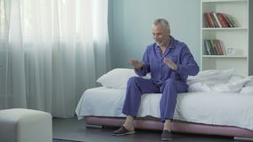 Mature man waking up in fine mood and feeling full of energy and cheerfulness. Stock footage stock video footage