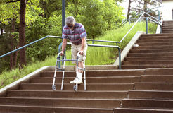 Mature man with walker Stock Images