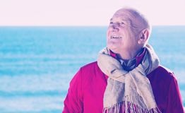 Mature Man Walking By Sea Stock Photos