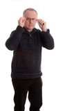 Mature man in warm sweater, adjusting his glasses Royalty Free Stock Photography