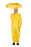 Mature Man Wearing Raincoat And Holding Umbrella Royalty Free Stock Photography