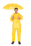 Mature Man Wearing Raincoat And Holding Umbrella Royalty Free Stock Photo