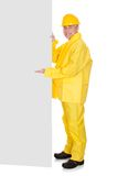 Mature Man Wearing Raincoat And Standing Behind Placard Stock Photos