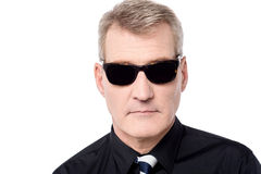 Mature man wearing sunglasses. Handsome man posing to camera with sunglasses Royalty Free Stock Photos