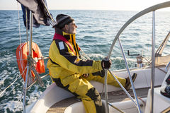 Mature Man Wearing Wind Jacket On Sailing Boat Royalty Free Stock Photos