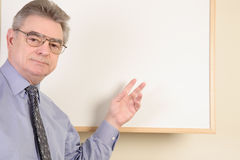 Mature man at whiteboard Stock Photography