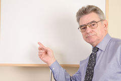 Mature man at whiteboard Royalty Free Stock Photography