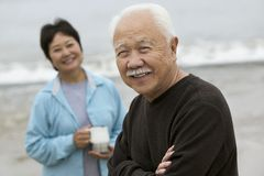 Mature man and wife at beach (portrait) Stock Photo
