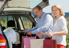 Mature man and woman with bags in hands Royalty Free Stock Photography