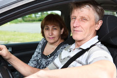Mature man and woman in car Stock Image
