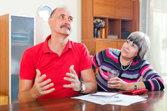Mature man and woman having financial problems Stock Photos