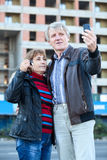 Mature man and woman making selfie with house key in hand Stock Images
