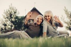 Mature man and woman posing at camera stock photos