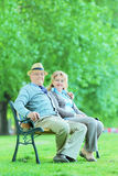 Mature man and woman relaxing in park stock photography