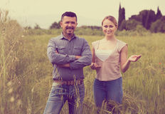 Mature man and woman standing in wheat field Stock Photography