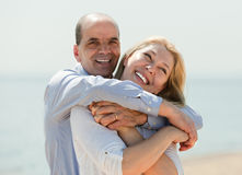 Mature man and woman together against sea Stock Image