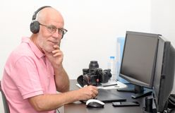 Mature man working on his graphics tablet royalty free stock image