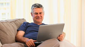 Mature man working on his laptop stock video footage