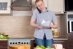 Mature man working at home. Self-employed mature man working at home Stock Photography