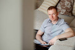 Mature man working at home Stock Photos