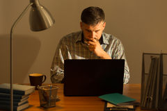 Mature man working at home Royalty Free Stock Images