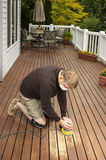 Mature man working on Natural Cedar Deck Royalty Free Stock Photo