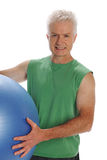 Mature man working out with a ball Stock Images