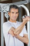 Mature Man Working Out In Fitness Center Stock Image