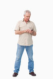 Mature man writing text message Royalty Free Stock Image