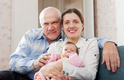 Mature man and young woman with  baby Stock Photo