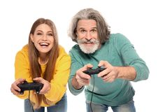 Mature man and young woman playing video games stock photo