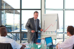 Mature manager speaking in a presentation Royalty Free Stock Photo