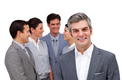 Mature manager standing with his team Royalty Free Stock Images