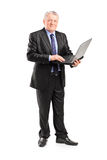 Mature manager working on a laptop Royalty Free Stock Images