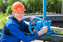 Mature manual worker with stop-gate valve Royalty Free Stock Images