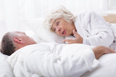 Mature marriage arguing in bed stock photography