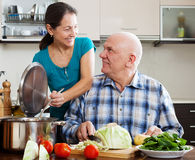 Mature married couple cooking lunch together Stock Photo