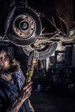 Mature mechanic at repair service station Stock Photography