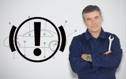 Mature mechanic standing next to hand break signal Royalty Free Stock Image
