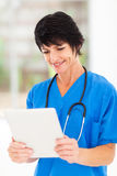 Mature medical worker tablet Stock Images