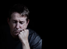 Mature men with eyes closed and chin in hand expressing negative Royalty Free Stock Images